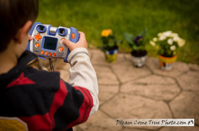 Dream Come True Photo: kid photographing flowers