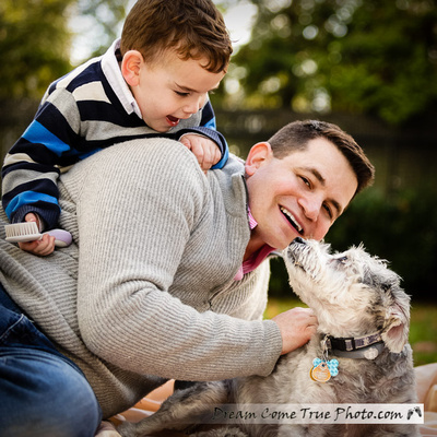 Dream Come True Photo: loving family with a dad, a son and their beloved dog are enjoying the time together