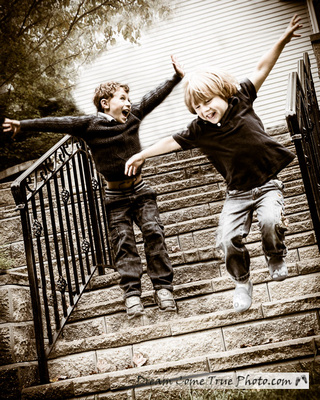 Dream Come True Photo: happy boys, brothers jumping off the staircase and having a blast on their family photo session while getting the best photograph ever!