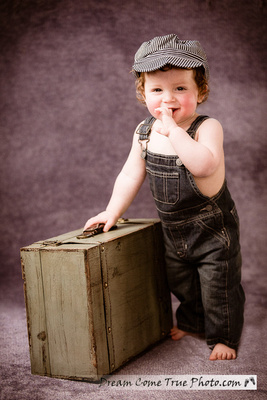 Dream Come True Photo: first birthday cake smash photoshoot - artistic image of an adorable little boy in a hat with suitcase