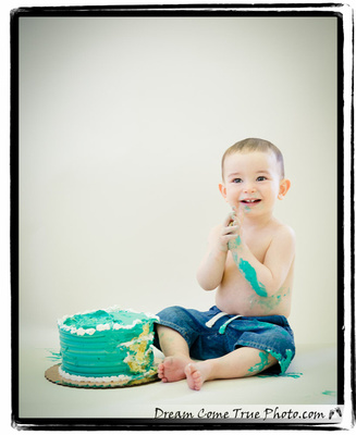 Dream Come True Photo: baby boy clapping during smash cake photo session in honor of his first birthday