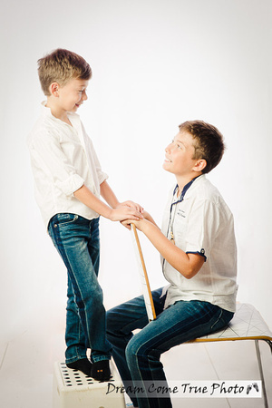 Artistic and creative portrait of two brothers, capturing authentic relationships between the boys in fun timeless portrait