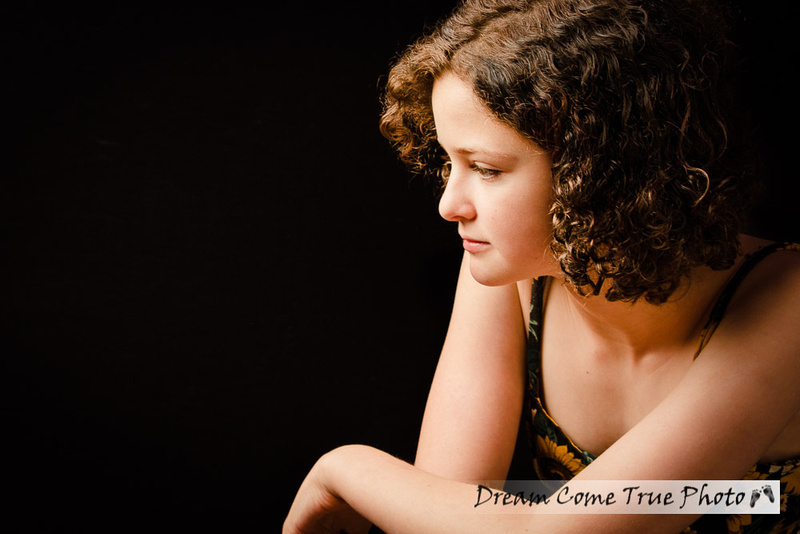 Artistic and glamorous portrait of a gorgeous teenage senior girl during a family photosession in Marlboro NJ